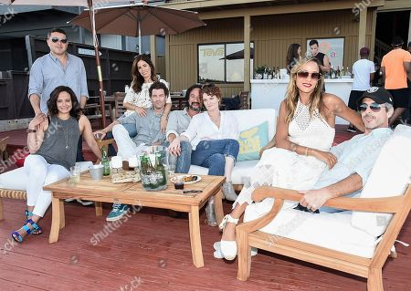 From left to right, actress Judy Reyes and her husband, actress Ana Ortiz and her husband, actress Rebecca Wisocky and her husband, and Dania Ramirez and her husband at the Kia Malibu Beach House Presented by Teva on in Malibu, Calif. Martinez, Wisocky and Reyes later live tweeted an episode of their television show Devious Maids