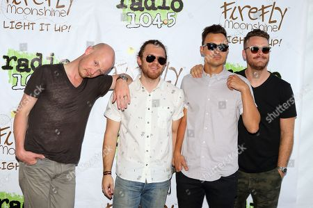 Stock Picture of Isaac Slade, from left, Dave Welsh, Joe King and Ben Wysocki of the band The Fray pose for photographers backstage at Festival Pier, in Philadelphia