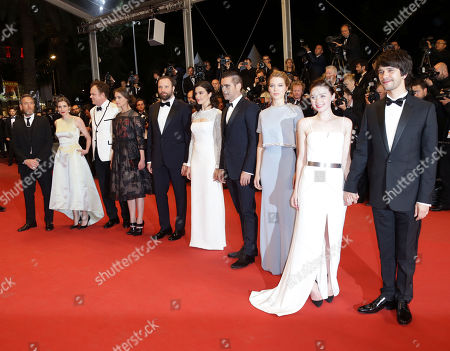 Stock Image of From left, Angeliki Papoulia, John C. Reilly, Ariane Labed, Yorgos Lanthimos, Lea Seydoux, Rachel Weisz,Jessica Barden and Ben Wishaw pose for photographers upon arrival for the screening of the film The Lobster at the 68th international film festival, Cannes, southern France