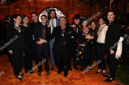 "John Lasseter, center, arrives with family and friends at the Los Angeles premiere of ""Coco"" at the El Capitan Theatre, in Los Angeles"