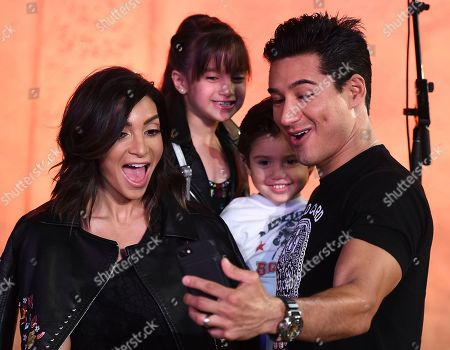 """Stock Photo of Mario Lopez, Dominic Lopez, Gia Francesca Lopez, Courtney Mazza. Mario Lopez, Dominic Lopez, Gia Francesca Lopez and Courtney Mazza arrive at the Los Angeles premiere of """"Coco"""" at the El Capitan Theatre, in Los Angeles"""