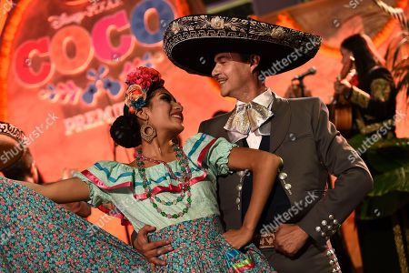 """Dancers perform at the start of the Los Angeles premiere of """"Coco"""" at the El Capitan Theatre, in Los Angeles"""