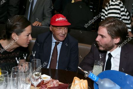 """From left, Birgit Wetzinger, Niki Lauda and Daniel Bruhl attend Universal Pictures """"RUSH"""" premiere after party sponsored by The Hollywood Reporter at The Thompson Hotel on day 4 of the Toronto International Film Festival, in Toronto"""
