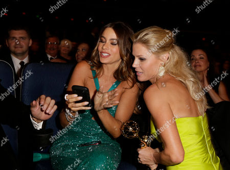 SEPTEMBER 23: Sophia Vergara (L) and Julie Bowen attend the Academy of Television Arts & Sciences 64th Primetime Emmy Awards at Nokia Theatre L.A. Live on in Los Angeles, California