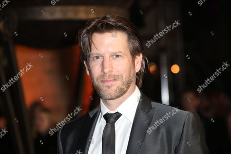Stock Picture of Andrew Tarbet poses for photographers upon arrival at the World premiere of the film Exodus: Gods And Kings in London