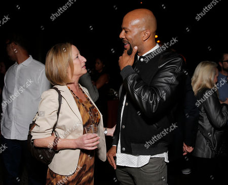 Fox Searchlight President of Production Claudia Lewis and Common attend Fox Searchlight's Los Angeles Premiere of 12 Years A Slave, on Monday, October, 4th, 2013 in Los Angeles