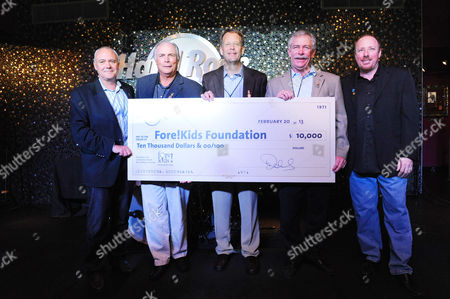Hamish Dodds, President and CEO of Hard Rock International, and Don Estep, General Manager of Hard Rock Cafe New Orleans, present representatives of the Fore!Kids Foundation with a $10,000 donation to celebrate the Grand Opening of the new Hard Rock Cafe New Orleans, in New Orleans. Pictured here from left to right, Hamish Dodds, Craig Silva, Steve Worthy, Eddie Boettner, and Don Estep