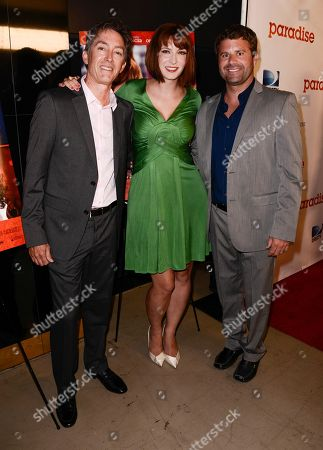 """Stock Image of RLJ Entertainment Chief Acquisitions Officer Bill Bromiley, left, writer and director Diablo Cody, center, and RLJ Entertainment VP of Acquisitions Mark Ward arrive on the red carpet at a special screening of the feature film """"Paradise"""" at the Chinese 6 Theater on in Los Angeles"""
