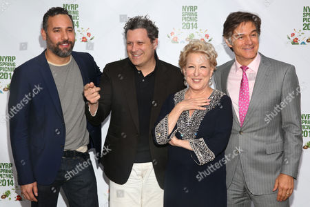 Arnold Germer, left, Izaac Mizrahi, second left, Bette Midler, and Dr. Mehmet Oz, right, attend the New York Restoration Project's 13th Annual Spring Picnic at Riverside Park, in New York