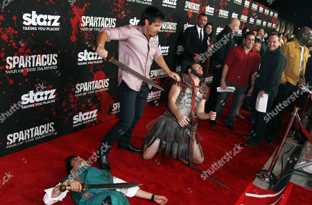 """Stock Image of Spartacus cast trainer Tyrone Bell, center, demonstrates sword fighting at the premiere of """"Spartacus: War of the Damned"""" on in Los Angeles. """"Spartacus: War of the Damned"""" premieres Friday, Jan. 25 at 9PM on STARZ"""