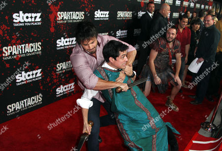 "Stock Image of Spartacus cast trainer Tyrone Bell, left, demonstrates sword fighting at the premiere of ""Spartacus: War of the Damned"" on in Los Angeles. ""Spartacus: War of the Damned"" premieres Friday, Jan. 25 at 9PM on STARZ"