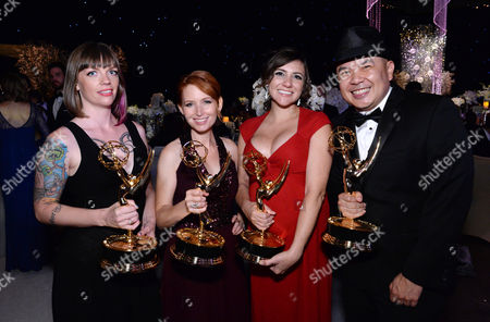 Alexandra Edwards, from left, Tamara Krinsky, Tracy Bitterrolf, and Bernie Su attend the Governors Ball for the Television Academy's Creative Arts Emmy Awards at LA Convention Center, in Los Angeles