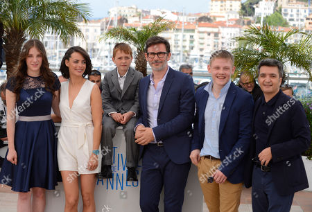 From left, Zukhra Duishvili, Berenice Bejo, Abdul-Khalim Mamatsuiev, Michel Hazanavicius, Maxim Emelianov and Thomas Langmann during a photo call for The Search at the 67th international film festival, Cannes, southern France
