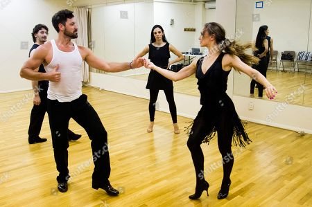 """In this photo, dancers Karina Smirnoff, right, and Maksim Chmerkovskiy rehearse for the upcoming Broadway show """"Forever Tango"""" as Juan Horvath, background left, and Victoria Galoto, look on in New York. Smirnoff and Chmerkovskiy, best known for their work on """"Dancing with the Stars,"""" will star in the revival of Luis Bravo's """"Forever Tango,"""" which traces the dance's birth on the streets of 19th-century Buenos Aires to its more modern manifestations"""