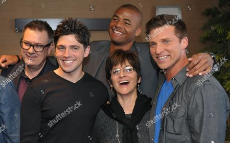 "Jill Farren Phelps, second from right, executive producer of ""The Young and the Restless,"" poses with, from left, the show's head writer Josh Griffith and cast members Robert Adamson, Redaric Williams and Steve Burton at the Hot New Faces of ""The Young and the Restless"" press junket at CBS Television City on in Los Angeles. The CBS show, daytime's top-rated soap since December 1988, hits the big 4-0 on Tuesday, March 26, 2013"