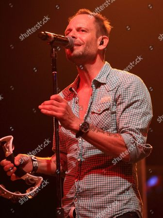 Robin Wilson of the rock band the Gin Blossoms performs on the Under The Sun 2013 Tour at The Electric Factory, in Philadelphia