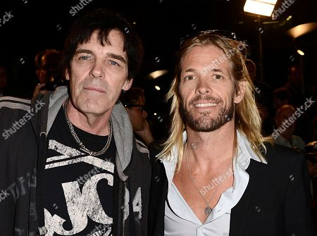 "From left to right, musician Richie Ramone and musician Taylor Hawkins arrive on the red carpet at the West Coast special screening of ""CBGB"" at the ArcLight Hollywood on in Los Angeles"
