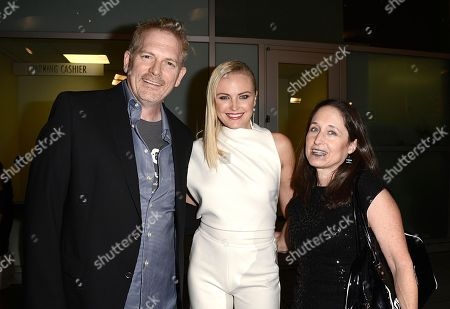 "From left to right, director Randall Miller, actress Malin Akerman and writer Jody Savin arrive on the red carpet at the West Coast special screening of ""CBGB"" at the ArcLight Hollywood on in Los Angeles"