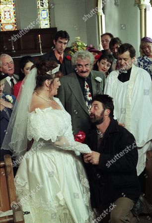 Ep 2254 Wednesday 10th September 1997 Betty tells a reluctant Zak he's got to go to the church and stop the wedding between Albert and Lisa otherwise he and Lisa may regret it for the rest of their lives. Dashing to the church Zak professes his love for Lisa and the whole congregation cheers. Reverend Ashley decides to bless the relationship outside - With Betty Eagleton, as played by Paula Tilbrook ; Eric Pollard, as played by Christopher Chittell ; Dee de la Cruz, as played by Claudia Malkovich; Lisa Clegg, as played by Jane Cox ; Zak Dingle, as played by Steve Halliwell ; Albert Dingle, as played by Bobby Knutt ; Marlon Dingle, as played by Mark Charnock ; Rev Ashley Thomas, as played by John Middleton.