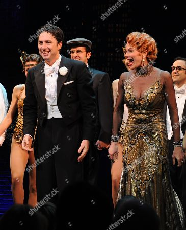 """Actor Zach Braff, left, and Marin Mazzie on stage during the curtain call for the opening night of """"Bullets Over Broadway"""" at the St James Theatre on in New York"""