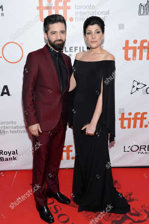 """Stock Picture of Navid Navid and Yasmine Asha attend a premiere for """"Septembers of Shiraz"""" on day 6 of the Toronto International Film Festival at Roy Thomson Hall, in Toronto"""