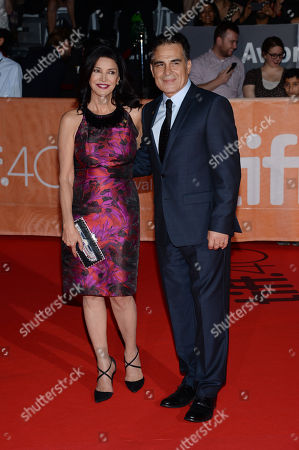 "Shohreh Aghdashloo and Houshang Touzie attend a premiere for ""Septembers of Shiraz"" on day 6 of the Toronto International Film Festival at Roy Thomson Hall, in Toronto"