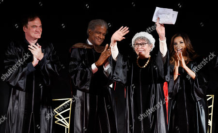 Honoree Rita Moreno, second from right, waves to the crowd as, from left, fellow honoree Quentin Tarantino and speakers Elvis Mitchell and Eva Longoria, right, applaud during the 2016 AFI Conservatory Commencement at the TCL Chinese Theatre, in Los Angeles