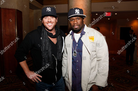 50 Cent, right, and Food Network's Scott Conant join Feeding America and the Food Bank for NYC to serve Thanksgiving meals to people in need at Cipriani on in New York