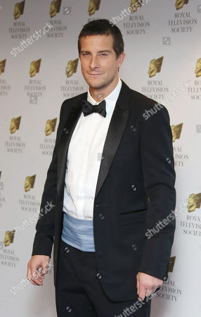 """Edward Michael """"Bear"""" Grylls poses for photographers upon arrival at the Royal Television Society Programme Awards at Grosvenor Hotel in central London"""