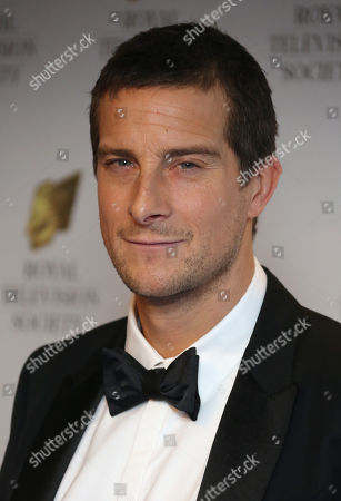 """Stock Image of Edward Michael """"Bear"""" Grylls poses for photographers upon arrival at the Royal Television Society Programme Awards at Grosvenor Hotel in central London"""