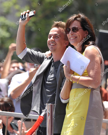 Frankie Muniz, left, and Jane Kaczmarek appear at Bryan Cranston's star ceremony on the Hollywood Walk of Fame on in Los Angeles