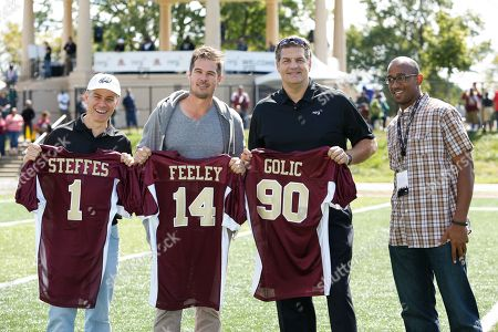 Tony Payton, right, Fairmount Park Conservancy Board Member, presents honorary jerseys at the North Philadelphia Aztecs' homecoming game to, from left to right, Jim Steffes, President NRG Retail Northeast, A.J. Feeley, former Philadelphia Eagles Quarterback, and Mike Golic, former Philadelphia Eagles Lineman at Hunting Park, on in Philadelphia