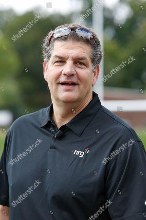 Mike Golic, former Philadelphia Eagles Lineman, serves as a commentator for the North Philadelphia Aztecs' homecoming game and community celebration sponsored by NRG Energy at Hunting Park in Philadelphia