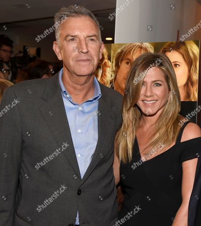 """Steve Beeks, COO and president, Lionsgate, left, and Jennifer Aniston arrive at the Los Angeles premiere of """"She's Funny That Way"""" at the Harmony Gold theater on"""