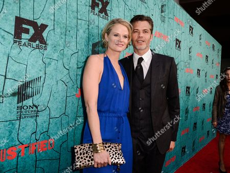 """Actors Timothy Olyphant, right, and actress Joelle Carter attend the screening for the television series finale of FX's """"Justified"""" in Los Angeles on"""