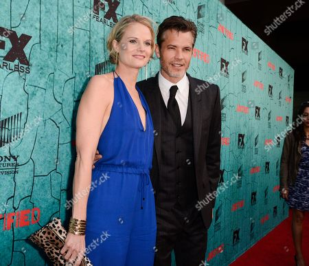 """Actor Timothy Olyphant, right, and actress Joelle Carter attend the screening for the television series finale of FX's """"Justified"""" in Los Angeles on"""