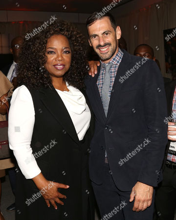 """Stock Image of Oprah Winfrey, left, and executive producer, David Shadrack Smith attend the after-party for the premiere of the Oprah Winfrey Network's (OWN) documentary series """"Belief"""", at The TimesCenter, in New York"""