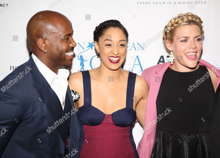 From left, Dolvett Quince, Tia Mowry, and Busy Philipps attend The Norma Jean Gala 2014 at The Paley Center for Media on in Beverly Hills, Calif