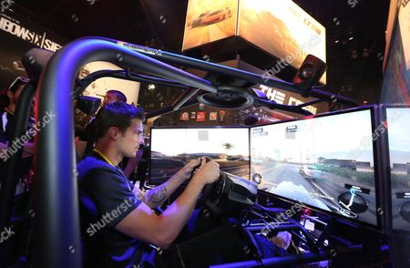 "Stock Image of Rick Malambri plays ""The Crew"" at the Ubisoft booth at E3, at the Los Angeles Convention Center"