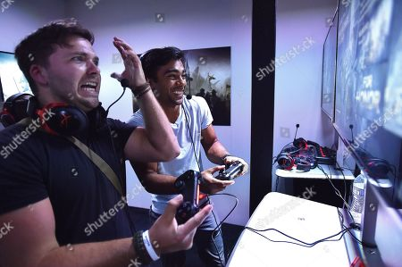 Stock Image of IMAGE DISTRIBUTED FOR UBISOFT - Stephen Lunsford, left, and Brennan Mejia play For Honor at Ubisoft E3 2016 - Day 1 at the Los Angeles Convention Center, in Los Angeles