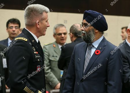 US General John Nicholson, Commander Resolute Support Mission in Afghanistan (L) and Canadian Defense Minister Harjit Sajjan attend the second day of NATO Defense Ministers council with resolute support operational partner nations at alliance headquarters, in Brussels, Belgium, 09 November 2017. NATO counterparts are on the second day of two days of talks looking to expand the military alliance's command structure and drum up more troop contributions for Afghanistan.