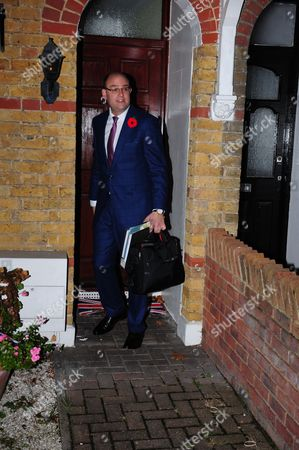Alex Sawyer, husband of Priti Patel, leaving their South East London home