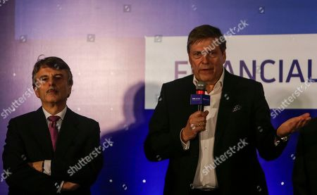 Guenter Butschek, Ralf Speth. Tata Motors Chief Executive Officer and Managing Director Guenter Butschek interacts with media as Jaguar Land Rover CEO Ralf Speth accompanies him during the announcement of second quarter financial results in Mumbai, India