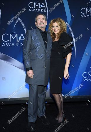 Jimmy Webb, Laura Savini. Songwriter Jimmy Webb and Laura Savini pose in the press room at the 51st annual CMA Awards at the Bridgestone Arena, in Nashville, Tenn