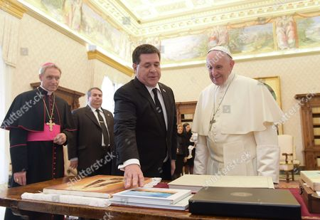 Pope Francis meets the President of Paraguay Horacio Manuel Cartes Jara in the Private Library of the Apostolic Palace.