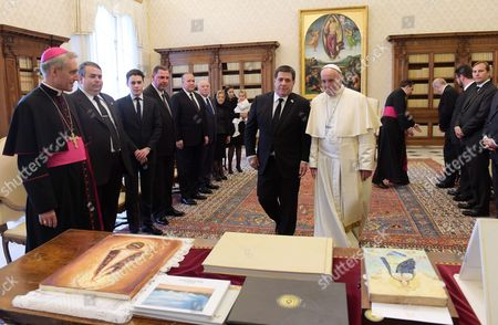 Stock Picture of Pope Francis meets the President of Paraguay Horacio Manuel Cartes Jara in the Private Library of the Apostolic Palace.