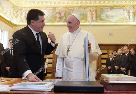 Stock Photo of Pope Francis meets the President of Paraguay Horacio Manuel Cartes Jara in the Private Library of the Apostolic Palace.