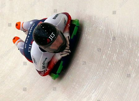 Lizzie Yarnold, of Britain, rounds a curve during the women's World Cup skeleton race in Lake Placid, N.Y., on . Yarn old placed third in the event