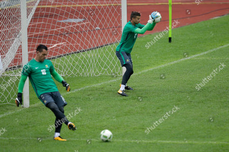 Mitchell Langerak, Danny Vukovic. Australia goalkeepers Mitchell Langerak, right, and Danny Vukovic take part on a training session at the Olympic Stadium in San Pedro Sula, Honduras, . Australia and Honduras will face for the first leg of the World Cup playoff on Friday