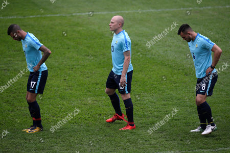Matthew Jurman, Aaron Mooy, Bailey Wright. Australia's Matthew Jurman, left, Aaron Mooy, center, and Bailey Wright stretch during a training session at the Olympic Stadium in San Pedro Sula, Honduras, . Australia and Honduras will face for the first leg of the World Cup playoff on Friday